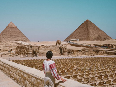 A person looking at the pyramids in Egypt