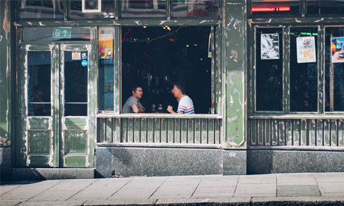 Two customers sat in a cafe window