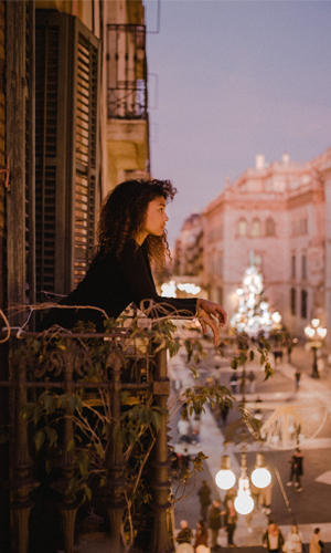 A person on a balcony in Barcelona