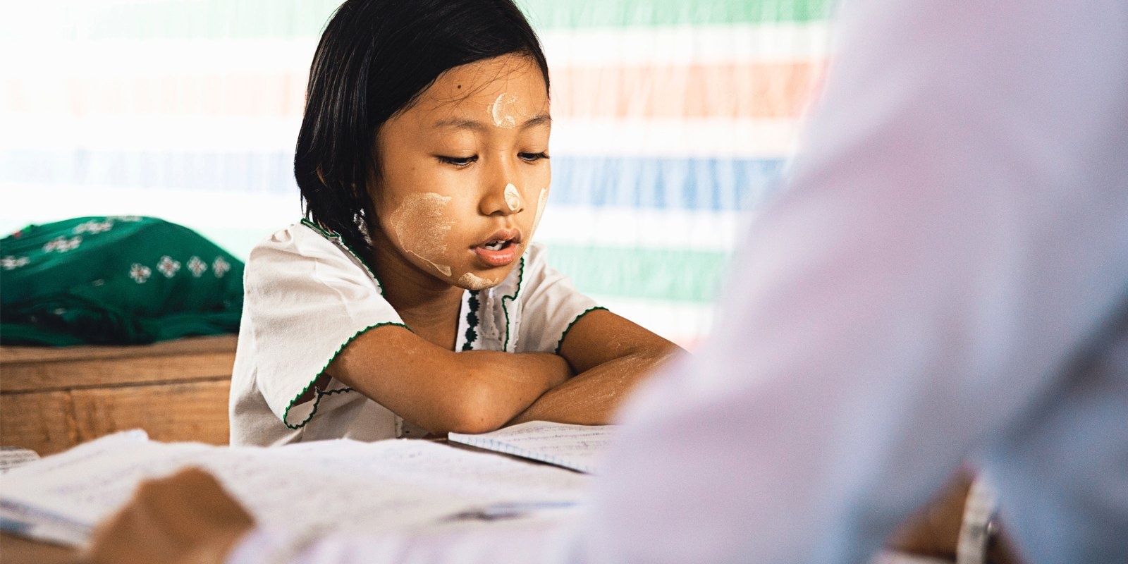A child studying with a tutor
