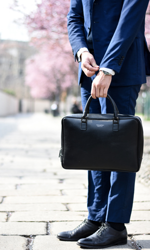A person in a suit with a briefcase