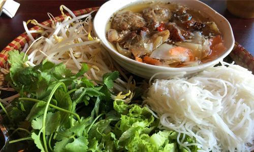 A bowl of bun cha with noodles, coriander and bean sprouts