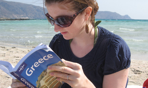 A person reading a travel book