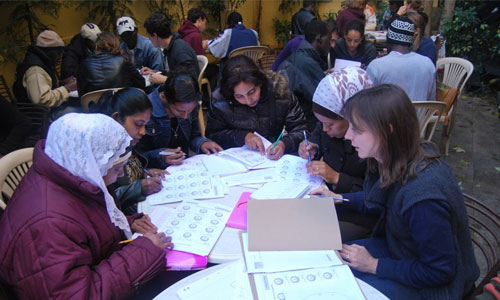 A TEFL class doing group work