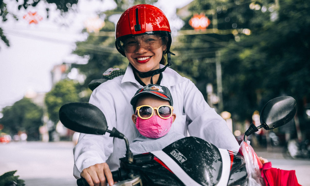 A parents and child on a motorbike in Vietnam